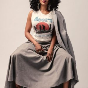 Simone Missick in a dress spreading her legs
