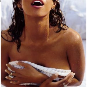 Stacey Dash covering her boobs